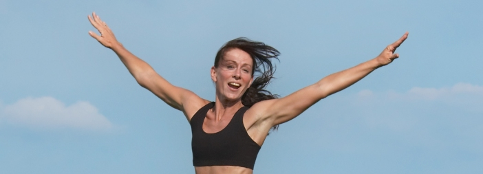 Fit woman jumping